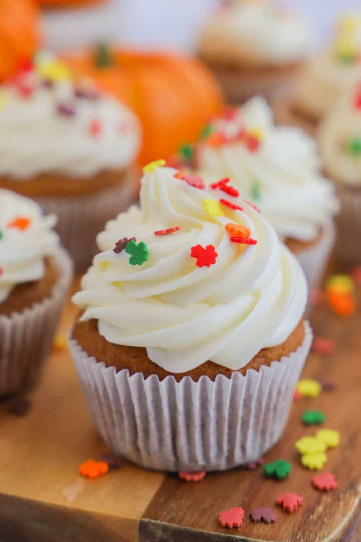 Pumpkin Cupcakes on wooden serving board