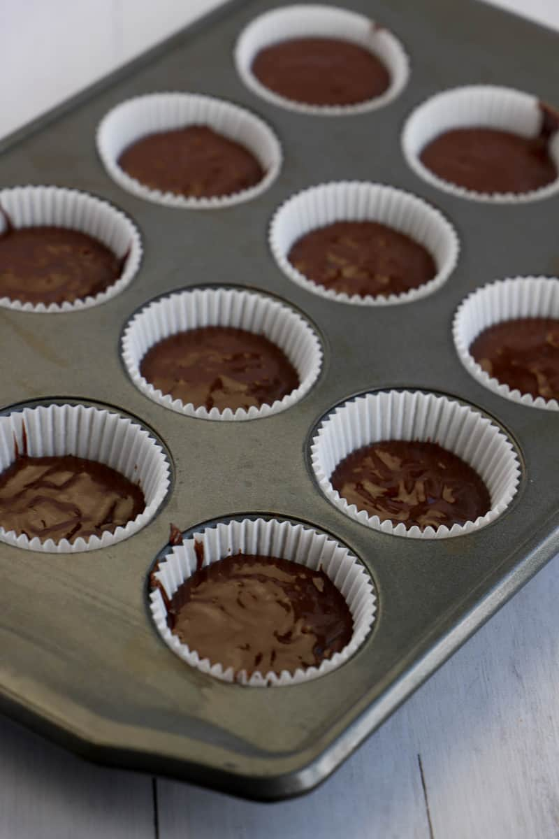filling your cupcake liners with the batter