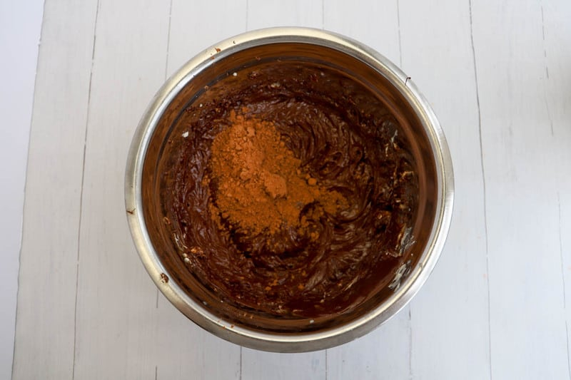 mixing ingredients for chocolate buttercream icing