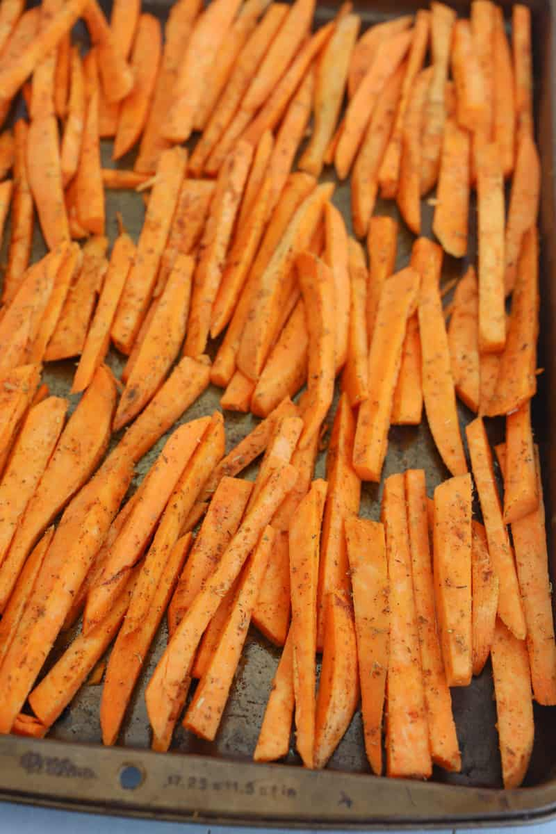 sweet potato fries laid out on a baking sheet