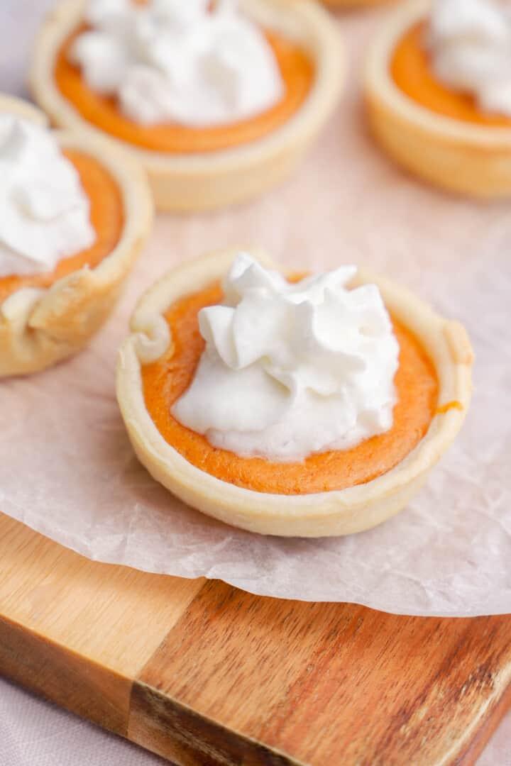 Mini Pumpkin Pies on wooden board
