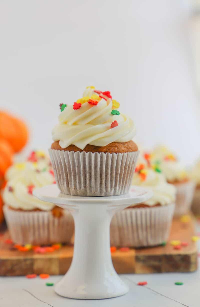 pumpkin cupcake on white stand