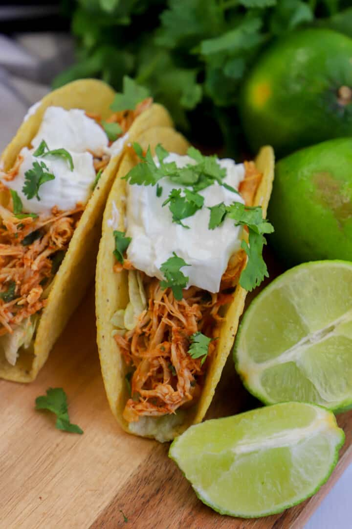 cilantro lime chicken tacos close up on wooden board