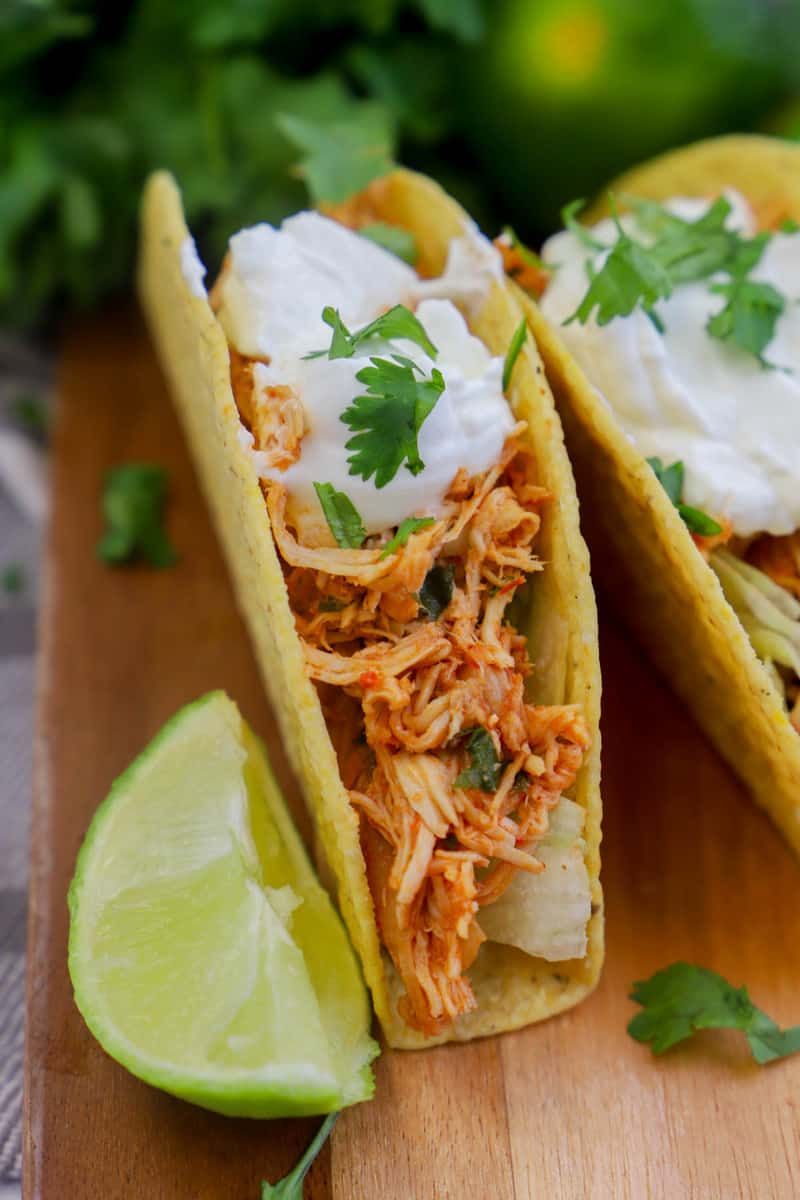 Slow Cooker Cilantro Lime Chicken Tacos closeup on wooden board