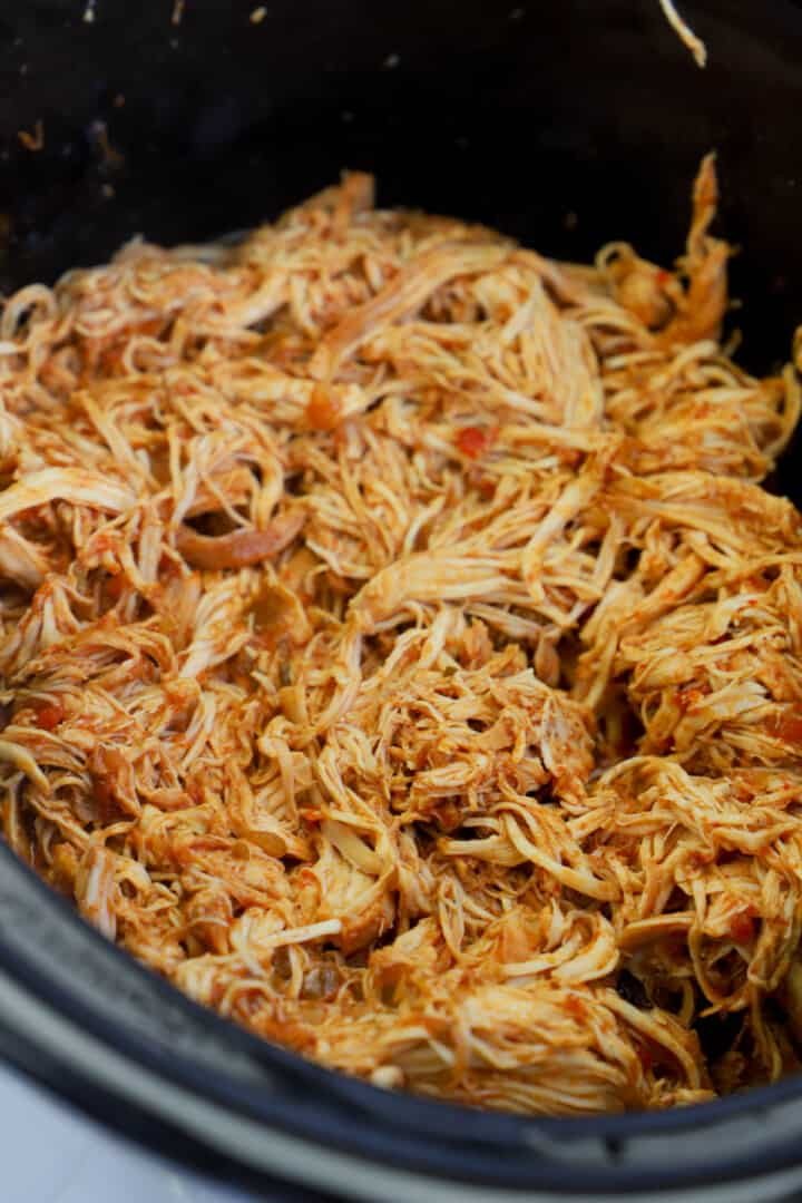 cooked cilantro lime chicken shredded in slow cooker